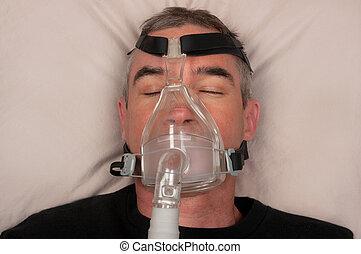 Sleep Apnea and CPAP - Man with sleep apnea and CPAP machine