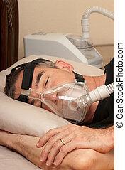 Sleep Apnea and CPAP - Man with sleeping apnea and CPAP...