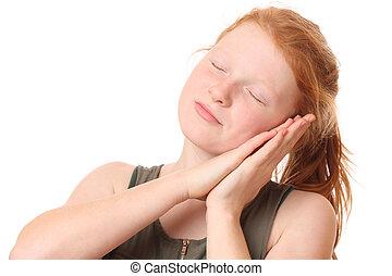 Sleep - Portrait of a teenage girl doing sleep gesture on...