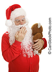 Santa in his pajamas with his teddy bear, giving a big yawn. Isolated on white.