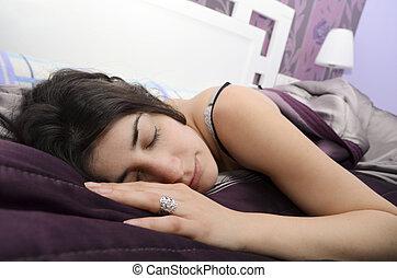 Sleeping a great siesta. Girl in bedroom.