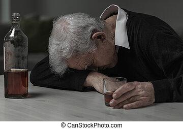 Sleeping after alcohol - Senior man sleeping after drinking...