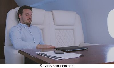 Sleeping at private jet. - Stewardess taking care of...