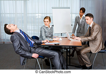 Sleeping at work - Photo of displeased businesspeople...