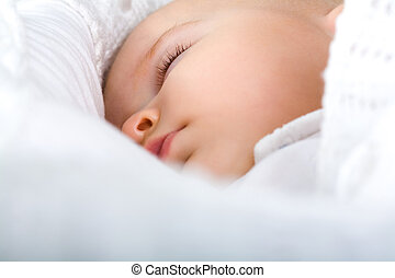 Sleeping baby - Close-up of adorable baby having sweet dream...