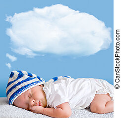 sleeping baby closeup portrait with dream cloud for image or...