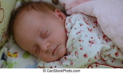 Sleeping baby closeup - Little baby girl is sleeping in her...