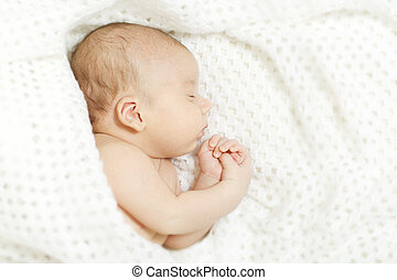 Sleeping baby covered with white blanket