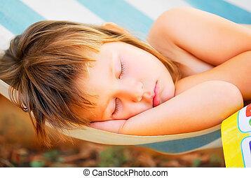 sleeping baby in the hammock