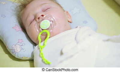 Sleeping baby - In crib sleeping baby with pacifier