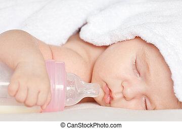 Sleeping baby with bottle