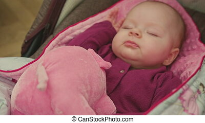Sleeping Baby with Toy Spins Her Head