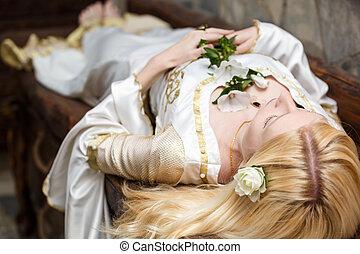 Sleeping beauty lying on the table