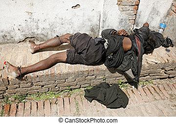 sleeping beggar - Bhaktapur, Nepal - 13 April 2008. Sleeping...