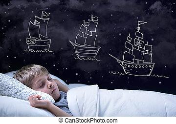 Sleeping little boy having a dream about big adventure