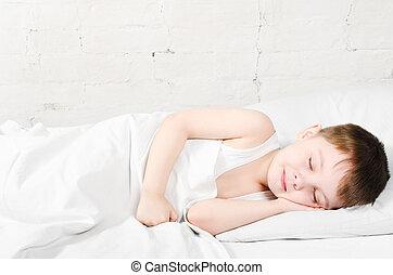 Sleeping boy - Small boy (4 years) is sleeping near the ...