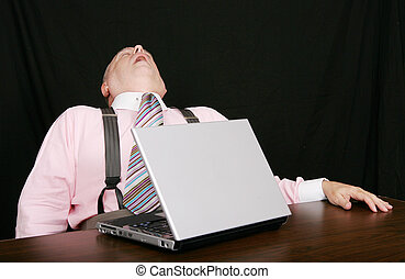 sleeping business man at his desk - business man sleeping on...