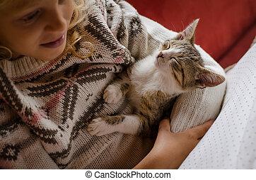 sleeping cat and child