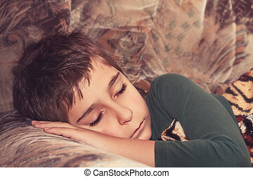 Sleeping child.  Toned image.