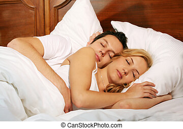 sleeping couple - a attractive young couple is sleeping in ...