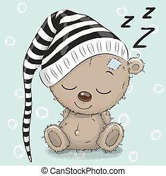 Sleeping cute Teddy Bear in a hood