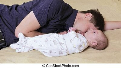 Sleeping Daddy with baby