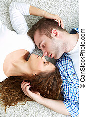 Sleeping dates - Young serene couple sleeping together