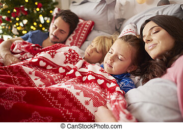 Sleeping family in Christmas morning