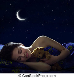 Sleeping Girl at night on background of the moon
