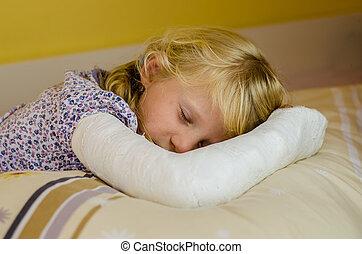 sleeping girl with bandage