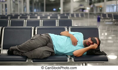 sleeping in airport with eye cover
