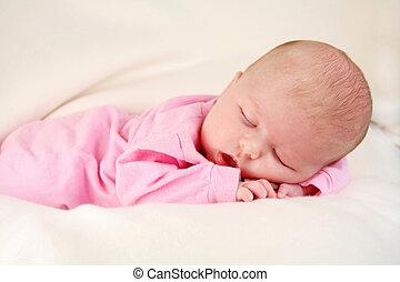 Sleeping Infant - Cute baby girl sleeping with her hands...