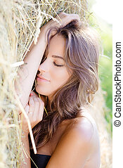 Sleeping lady on hay stack