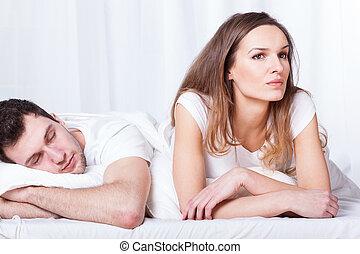 Sleeping man and thoughtful woman