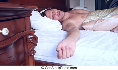 Sleeping man turns to light, while dreaming in a double bed...