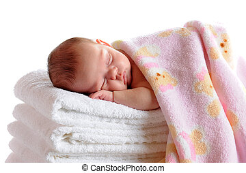 Sleeping Newborn - A beautiful newborn sleeping on a stack...