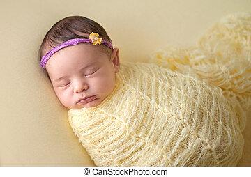 Sleeping Newborn Baby Girl Swaddled in Yellow - A portrait...