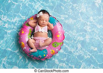 Sleeping Newborn Baby Girl Wearing a Bikini