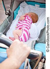 sleeping newborn baby in the pram