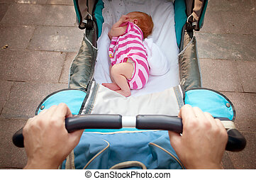 sleeping newborn baby in the pram