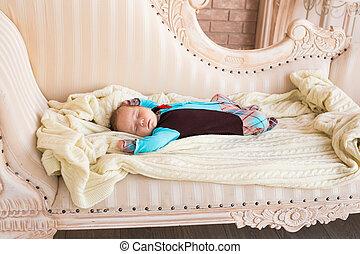 sleeping newborn baby on a blanket