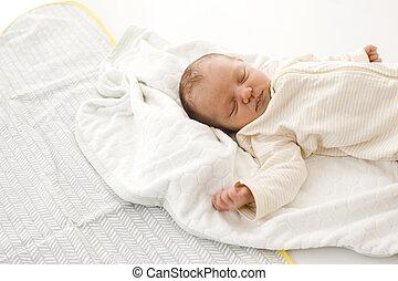 Sleeping newborn baby on blanket