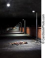Sleeping outdoors - Asian girl lies in an empty street