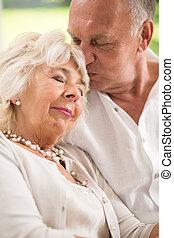 Sleeping wife and caring husband