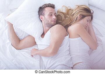 Sleeping woman and awaken man