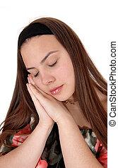 Sleeping young teenager on her hands