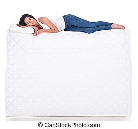 Sleeping - Young woman is lying on the mattress. Isolated on...