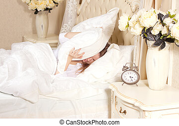 Sleepless woman lying in bed