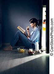 Sleepless woman reading in the kitchen - Sleepless woman...
