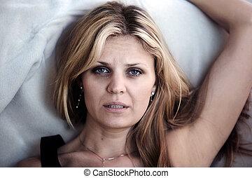Sleepless woman - Woman in pain having problems sleeping